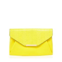 Red Herring - Yellow snakeskin envelope clutch bag