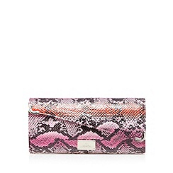 Red Herring - Pink asymmetric snakeskin clutch bag