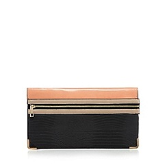 Red Herring - Orange zip front reptile clutch bag