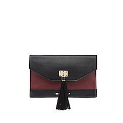 Red Herring - Dark red textured tassel clutch bag