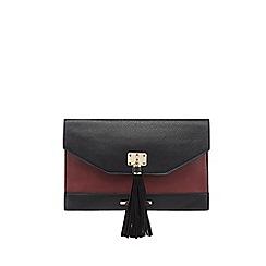 Red Herring - Dark red textured tassel clutch bag