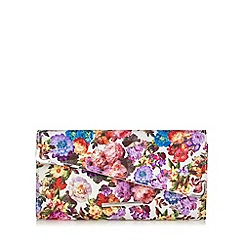 Red Herring - White floral clutch bag