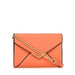 Call It Spring - Coral 'Pancake' clutch bag