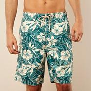 Green hibiscus flower swim shorts