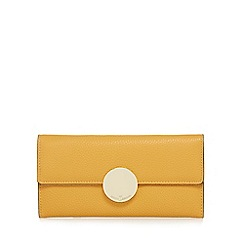 J by Jasper Conran - Dark yellow circle fitting large flap-over purse