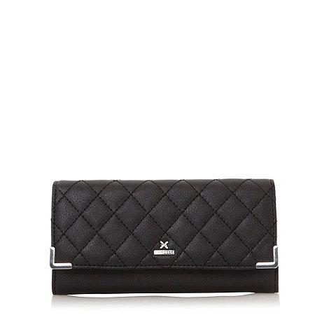 Fiorelli - Black quilted flapover purse