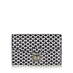 Mantaray - Navy butterfly printed push lock medium purse