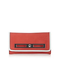 Principles by Ben de Lisi - Designer coral piped twist lock large purse