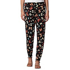 Red Herring - Black butterfly print jersey trousers