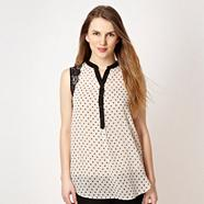 Black spotted sleeveless shirt