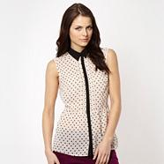 Black spotted sleeveless peplum shirt