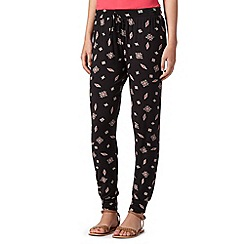 Red Herring - Black tile print jersey trousers