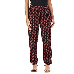 Red Herring - Black and red floral print trousers
