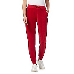 Red Herring - Red velour jogging bottoms