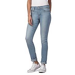 Levi's - Blue 311 mid-wash skinny jeans