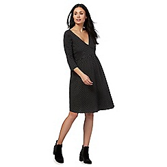 Red Herring Maternity - Black polka dot mock wrap maternity dress