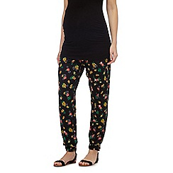 Red Herring Maternity - Black tropical print maternity trousers