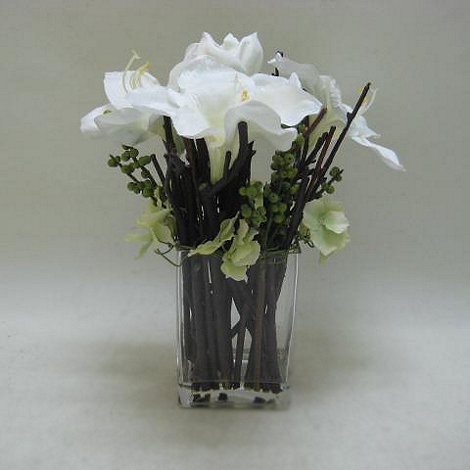 Grey Rose by Jane Packer - White Amaryllis flowers and berries in small glass vase