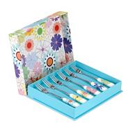 Set of six porcelain and stainless steel 'Crazy Daisy' pastry forks
