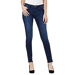Wrangler - Mid wash skinny fit 'Corynn' mid waisted jeans