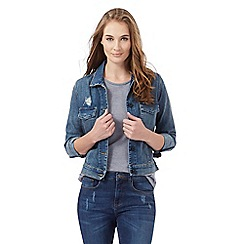Wrangler - Blue mid wash distressed-effect denim jacket