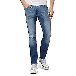 Wrangler - Blue mid wash slim leg jeans