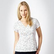 White leaf patterned V neck top