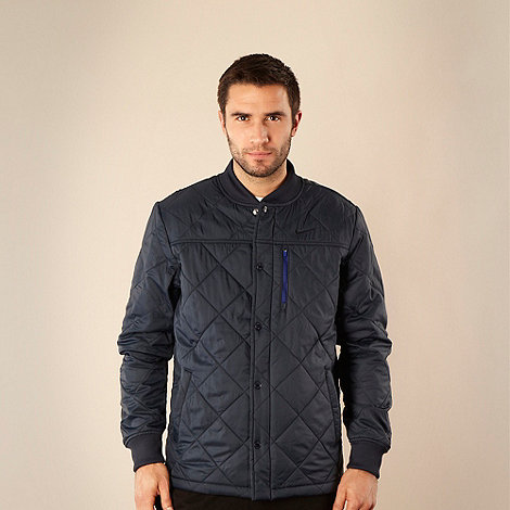 Nike - Navy three pocket quilted jacket