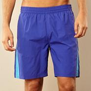 Bright blue branded swim shorts