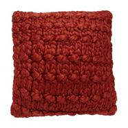 Designer burnt orange knitted cushion