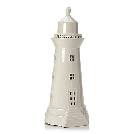 At home with Ashley Thomas - Ceramic white lighthouse lamp