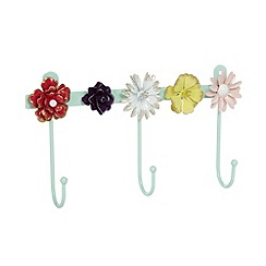 At home with Ashley Thomas - Metal flower hooks