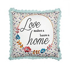 At home with Ashley Thomas - Aqua lace border 'Love' slogan cushion