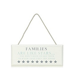 At home with Ashley Thomas - Cream 'Families Are Like Stars' hanging sign