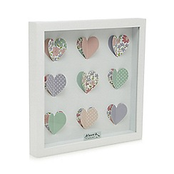 At home with Ashley Thomas - White cutout hearts polka dot and floral print wall art