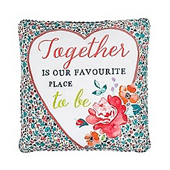 At home with Ashley Thomas - Pink 'Favourite Place To Be' floral cushion