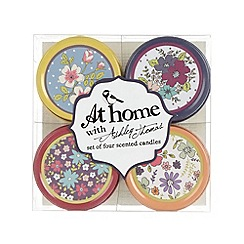 At home with Ashley Thomas - Set of four scented tin candles