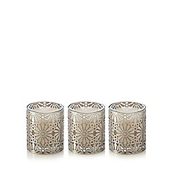 RJR.John Rocha - Set of three metal cutout floral lily scented candles