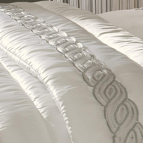 Kylie Minogue at home - White sequin wave throw