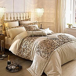 Kylie Minogue at home - Gold floral bed linen