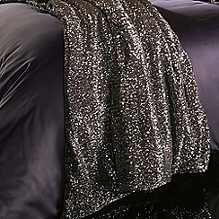 Kylie Minogue at home - Dark purple glitter throw
