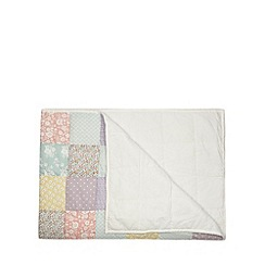 At home with Ashley Thomas - Pale pink patchwork throw