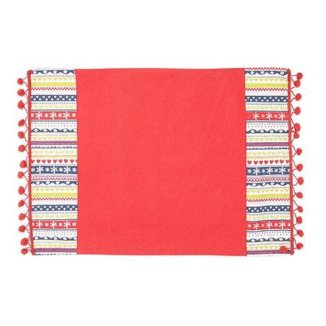 At home with Ashley Thomas - Red striped pom pom place mat