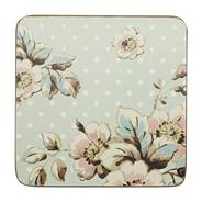 Set of six blue polka dotted floral coasters