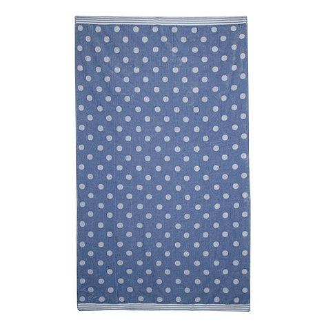 At home with Ashley Thomas - Lilac polka dot print beach towel