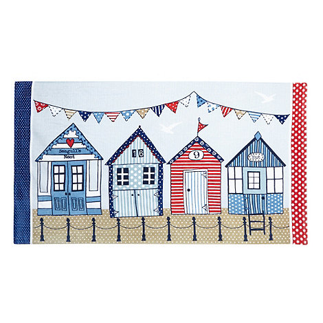 At home with Ashley Thomas - Multi-coloured beach huts print beach towel