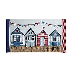 At home with Ashley Thomas - Multi-coloured beach huts print beach towel