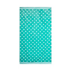 At home with Ashley Thomas - Aqua polka dot print beach towel