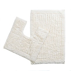Christy - Cream pedestal and bathmat set