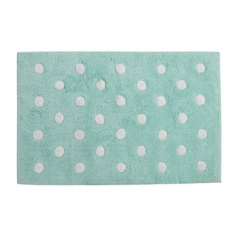 At home with Ashley Thomas - Pale green polka dot bathmat